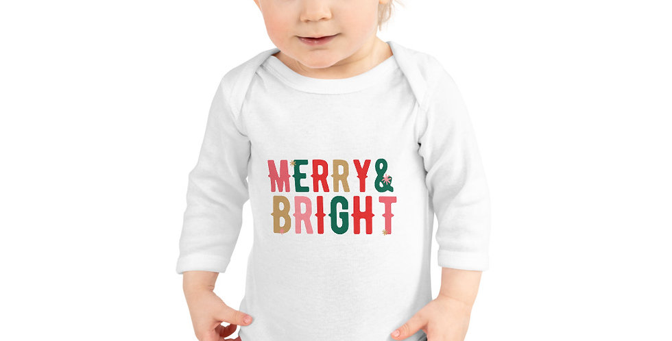 white babygrown with merry and bright multicoloured wording on front