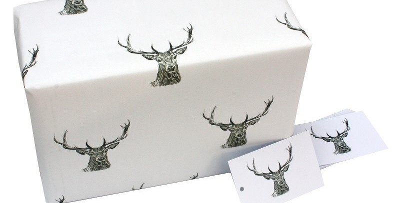 Stunning christmas wrapping paper. White background with black illustrated stag head pattern. Matching gift tags available.