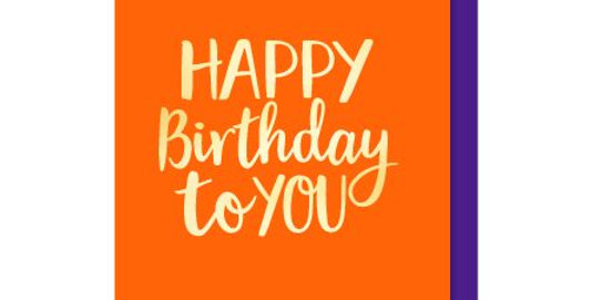 Birthday Card with orange background and gold writing saying Happy Birthday to you