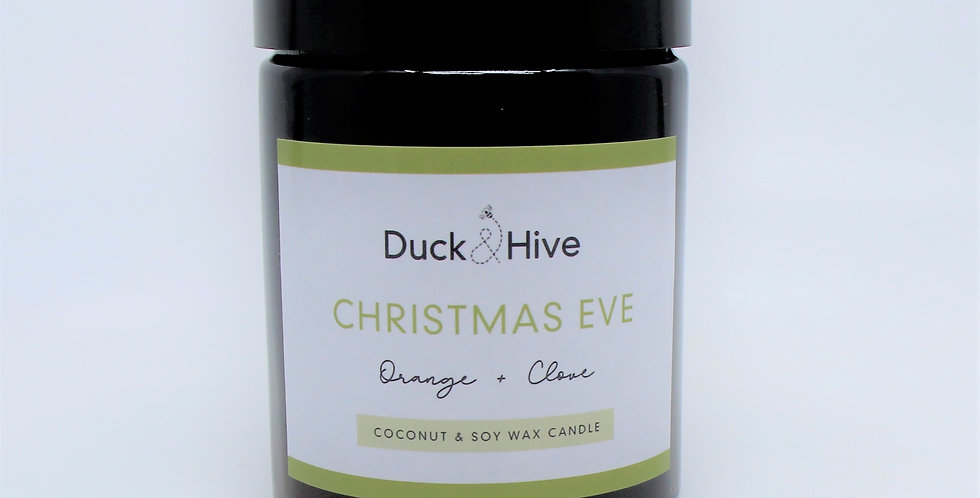 Christmas Eve scented soy wax candle with orange atop a warm and spicy base of cinnamon, nutmeg and clove scent
