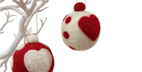 fairtrade felt bauble red and white with heart emblem