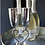 2 silver champagne flutes that form a heart with their stems when placed together