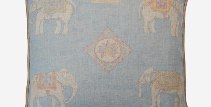 sky blue linen blend cushion showing small painterly elephants padding through a dusty landscape