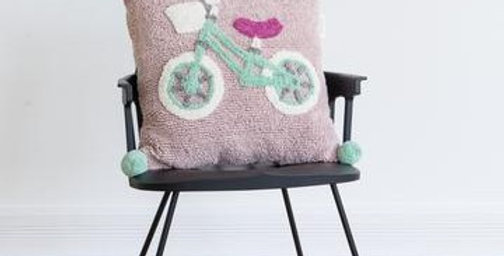 Square cushion with pale pink background and a bicycle in pale aqua, white  and fuschia pink