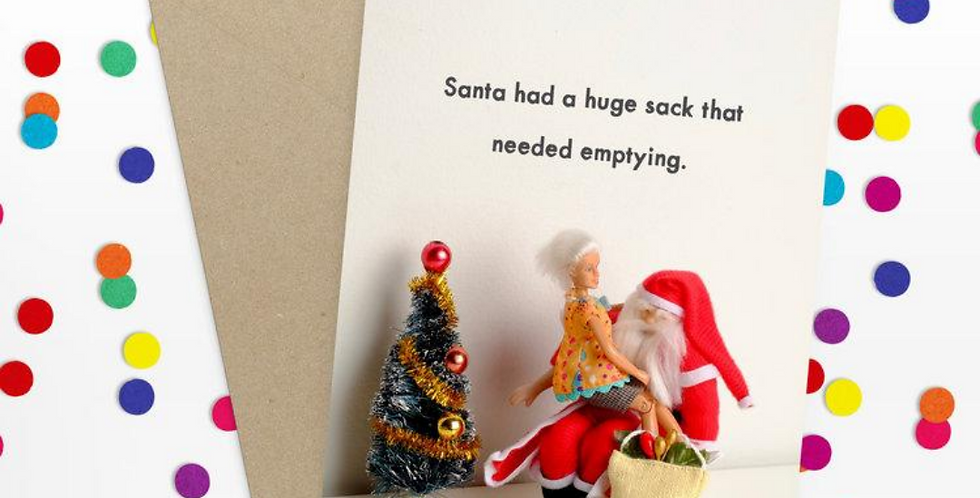 funny christmas card featuring barbie style doll sitting on santas lap and wording santa had a huge sack that needed emptying