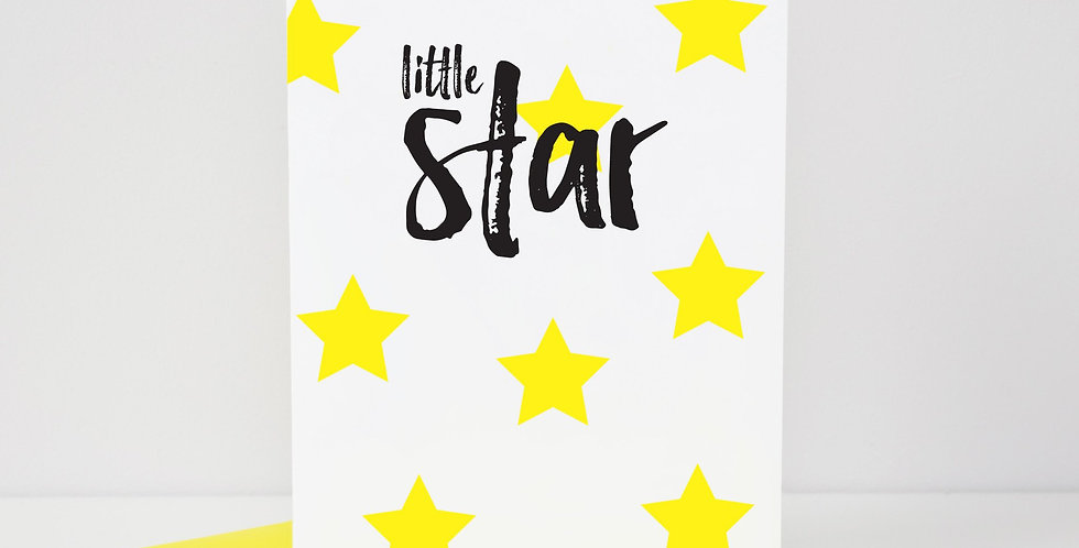 Congratulations card. White with bright yellow star pattern and black words saying little star