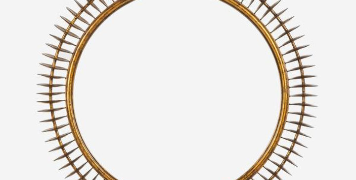 large, elegant circular mirror with a unique frame of gold disks strung together side-on, with a mottled metallic finish
