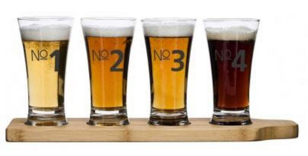 Beer tasting set with 4 glasse marked 1 to 4 served on a wooden serving tray
