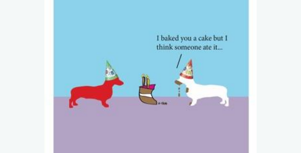 Birthday card withtwo dogs wearing party hats and a half eaten cake