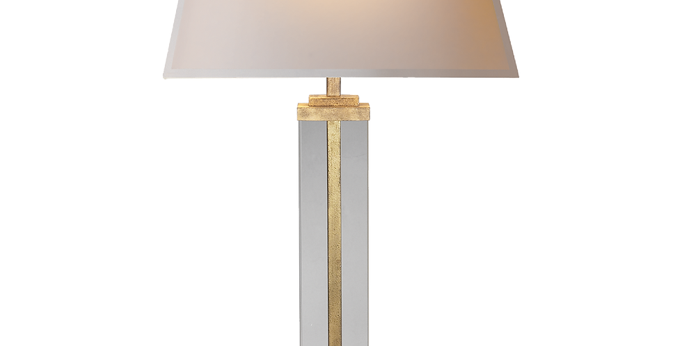 table lamp with a polished nickel base surrounded by a clear glass stem and topped with a natural shade. Boxy and clean cut.
