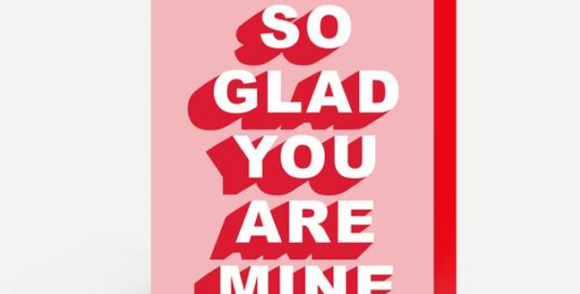 valentines day card pink background with white writing outlined in red with words so glad you are mine