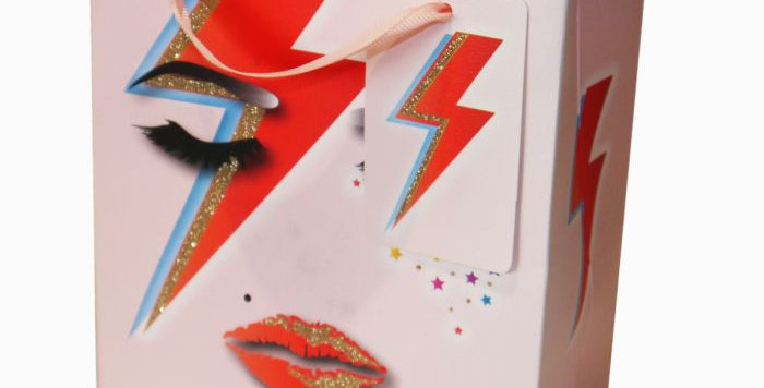 Small gift bag featuring a face similar to ziggy stardust