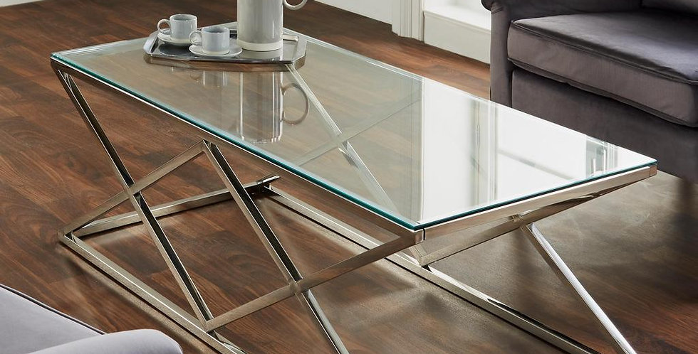 glass topped table with criss crossed silver legs
