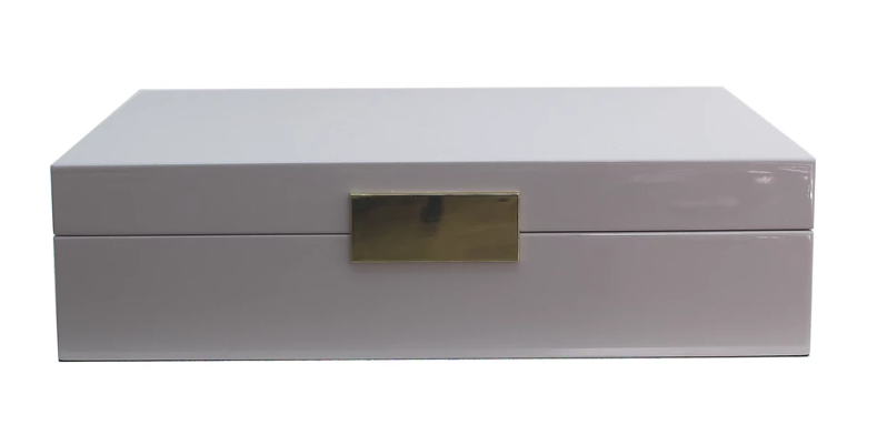 Lacquered White JewelleryBox features a goldplated clasp and matching hinges. Lined in cream suede.