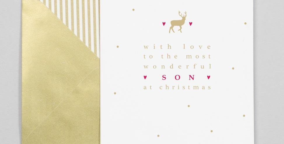 White card with gold dots. Gold reindeer and red/gold writing saying with love to the most wonderful son at christmas