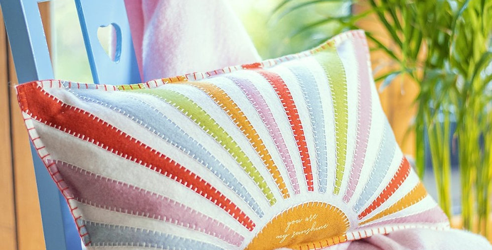 hand appliqued rainbow style rectangular cushion