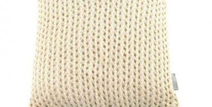 Cream natural knitted square cushion with cream tassels to each corner