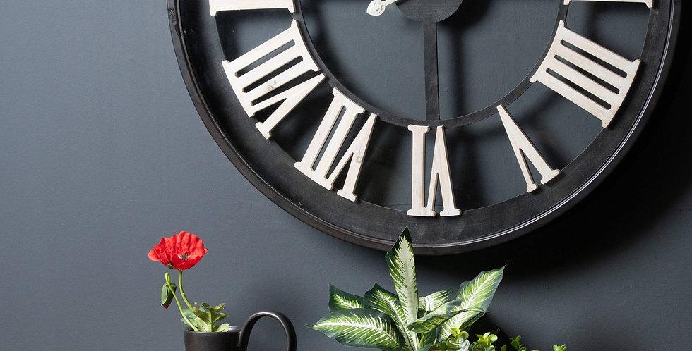 Black Framed Skeleton Clock With White Roman Numerals
