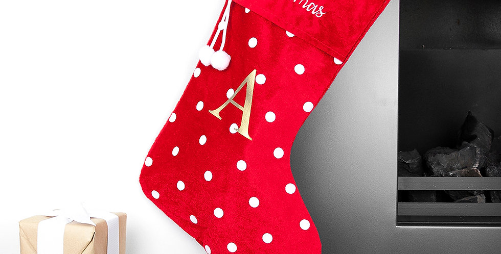 red stocking with white dots and personalised initial
