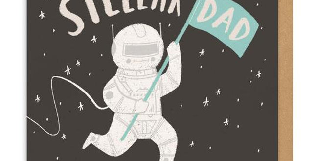 Astronaut in starry sky bouncing on moon with words stellar dad