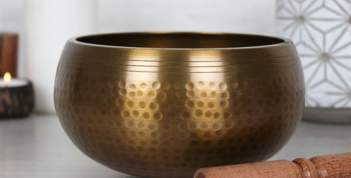 ethically sourced singing bowl is made from brass and features a simple hand beaten design, supplied with wooden stick