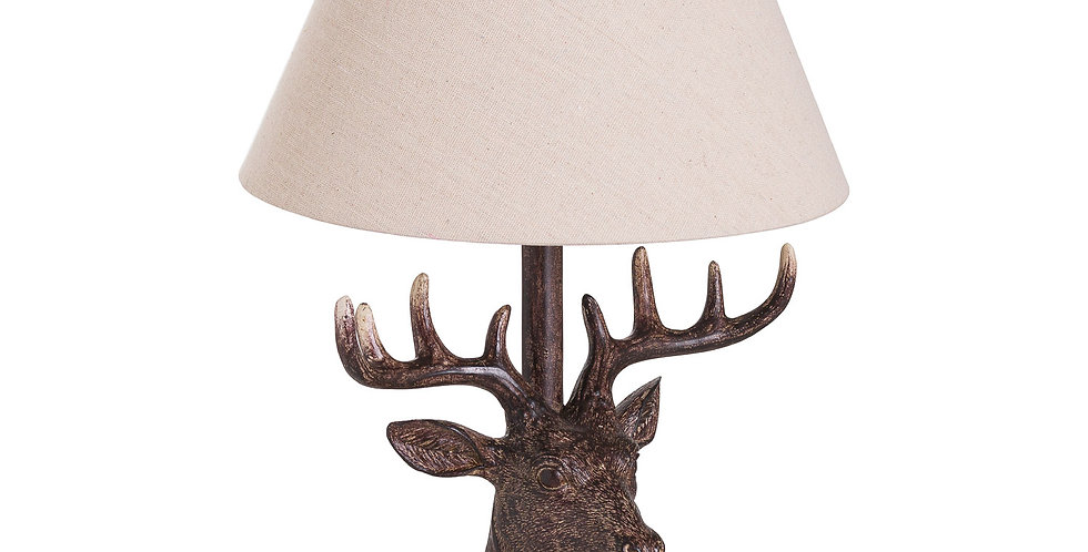 table lamp with stag head to base and linen lampshade