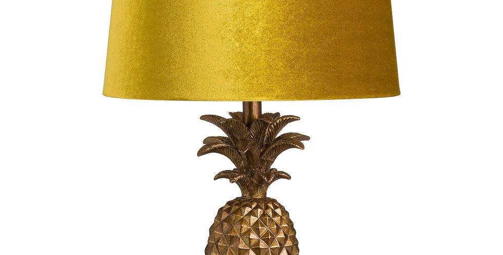 large antique gold lamp with pineapple shape and a mustard yellow lampshade