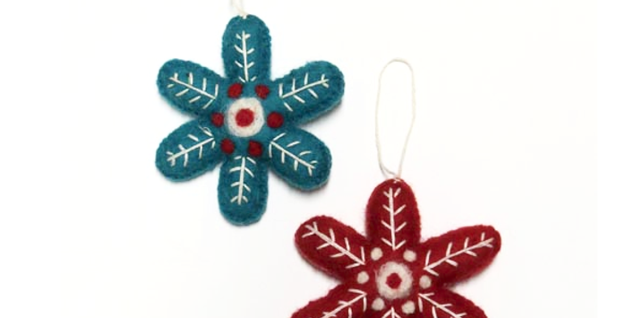 fairtrade felt bauble red, blue and white colouring shaped like a snowflake