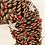 Pine cone christmas wreath with red berries and silver stars