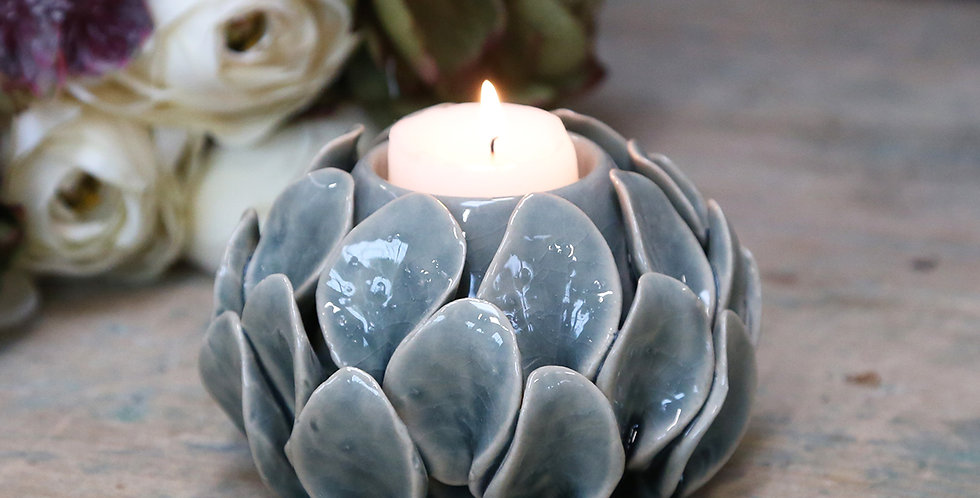 eye-catching candle holder with artichoke like leaves