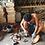 artisan making natural whitened coconut lamp