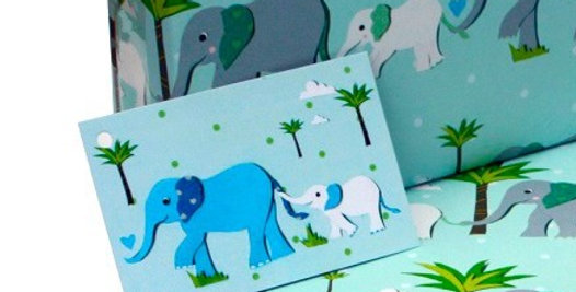 pale blue gift tag with father and son elephants