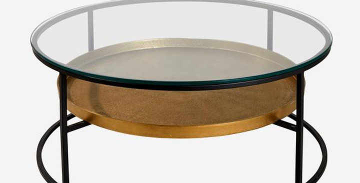 circular glass top coffee table with a black iron base and antique brass shelf perfect for displaying your favourite coffee t