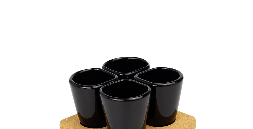 set of 4 black cups come with a light cork base that acts as both a trivet and a tray.