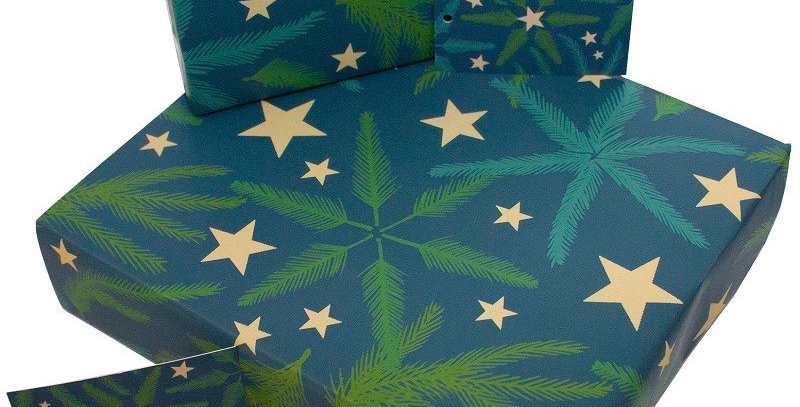 Christmas wrapping paper with bluey-green background and fir branches and gold stars. Matching gift tag available