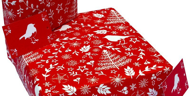 Christmas Wrapping Paper Christmas Scandi Robins.Red background with pattern of robins, Christmas trees, pine branches, stars