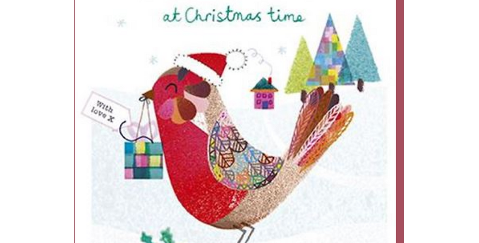 Christmas card with Robin wearing santa hat, with christmas trees & present and wording to a special auntie at christmas time