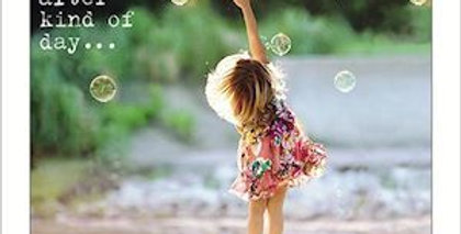 Friendship and support card with little girl outside catching bubbles and words have a happily ever after kind of day