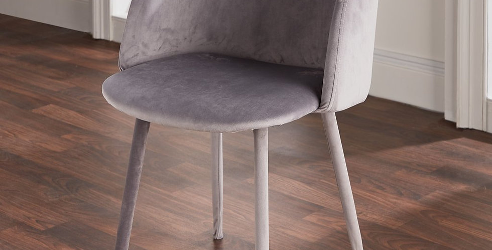 grey velvet dining chair with rounded shape