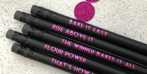 Black pencil set with saying that appeal to bakers like rise above it, flour power, bake it easy, that's how I roll