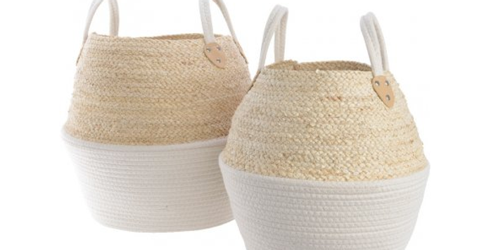 Set of two beehive-shaped corn leaf woven baskets in white and natural tone with handles, ideal for use as a laundry basket