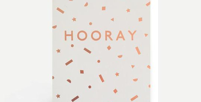 Birthday card with white background with rose gold confetti and wording saying Hooray