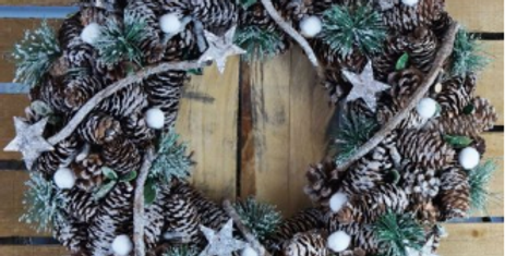Frosted berry wreath with pine cones