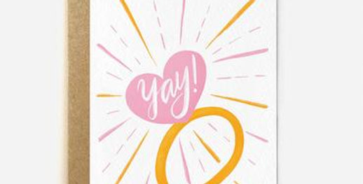 Stunning engagement card with illustrated ring the stone is a pink heart with word yay!, sparkles coming off ring