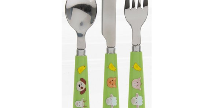 Toddler cutlery set with farmyard animals on green background