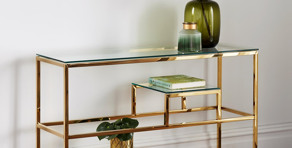 An elegant gold console table with levels or shelves for displaying items