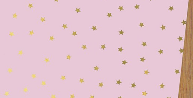 pale raspberry wrapping paper with gold star pattern