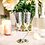 Two Champagne flutes with stems that form a heart when placed together