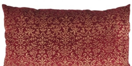 Burgundy cushion with gold heraldic pattern. Oblong.