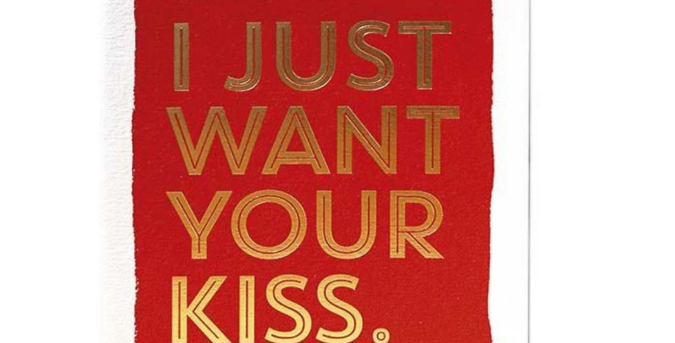 Romantic card with red background, white edging and bold gold writing saying I just want your kiss